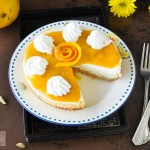 Cream cheesecake with mango cardamom Coulis