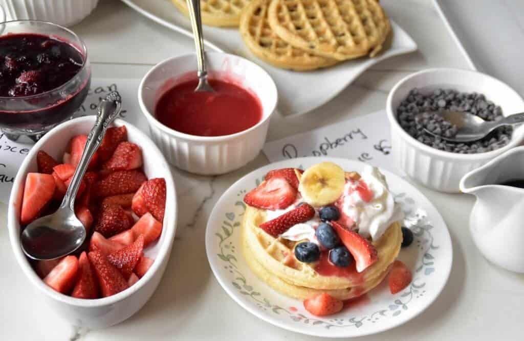 "<img src=""https://cdn.shortpixel.ai/client/q_glossy,ret_img,w_720,h_470/waffles.jpg"" alt=""Waffle bar with homemade sauces "">"