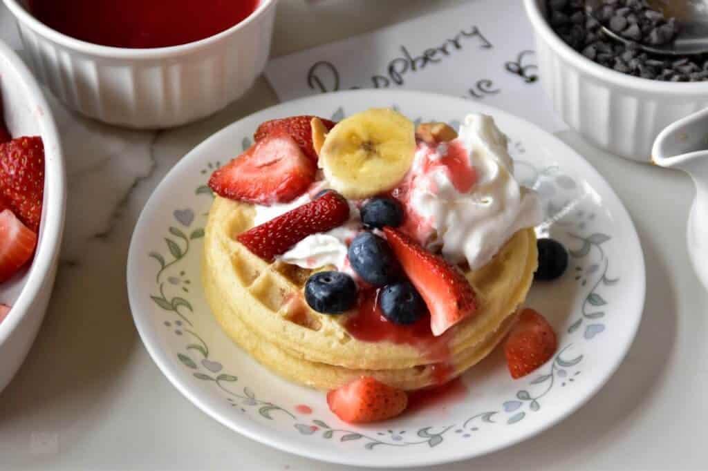 "<img src=""https://cdn.shortpixel.ai/client/q_glossy,ret_img,w_720,h_480/waffles.jpg"" alt=""Waffle bar with homemade sauces "">"