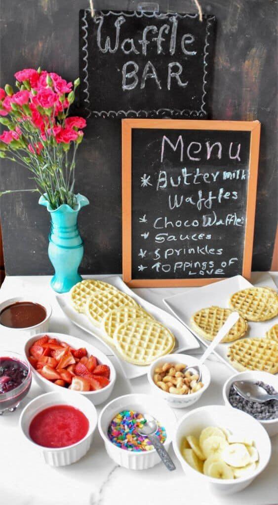 """<img src=""""https://cdn.shortpixel.ai/client/q_glossy,ret_img,w_563,h_1024/waffles bar.jpg"""" alt=""""Waffle bar with homemade sauces """">"""