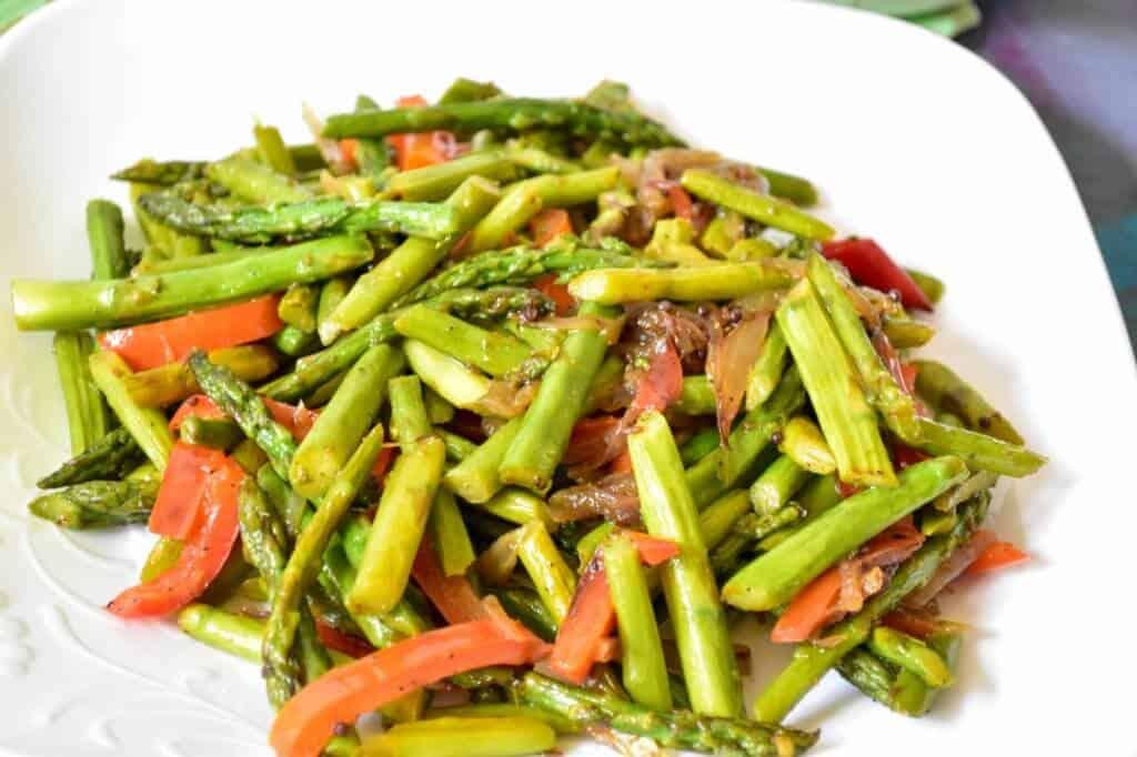 "<img src=""https://cdn.shortpixel.ai/client/q_glossy,ret_img,w_720,h_480/asparagus stir fry3.jpg"" alt=""Asparagus stir fry with mild spices 3 >"