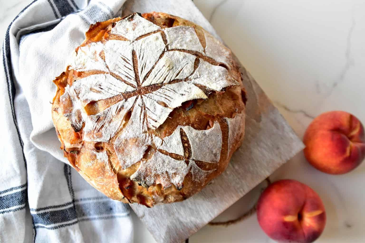 "<img src=""https://cdn.shortpixel.ai/client/q_glossy,ret_img,w_4096,h_2730/peach spelt sourdough bread .jpg"" alt="" peach spelt sourdough bread with peaches"">"