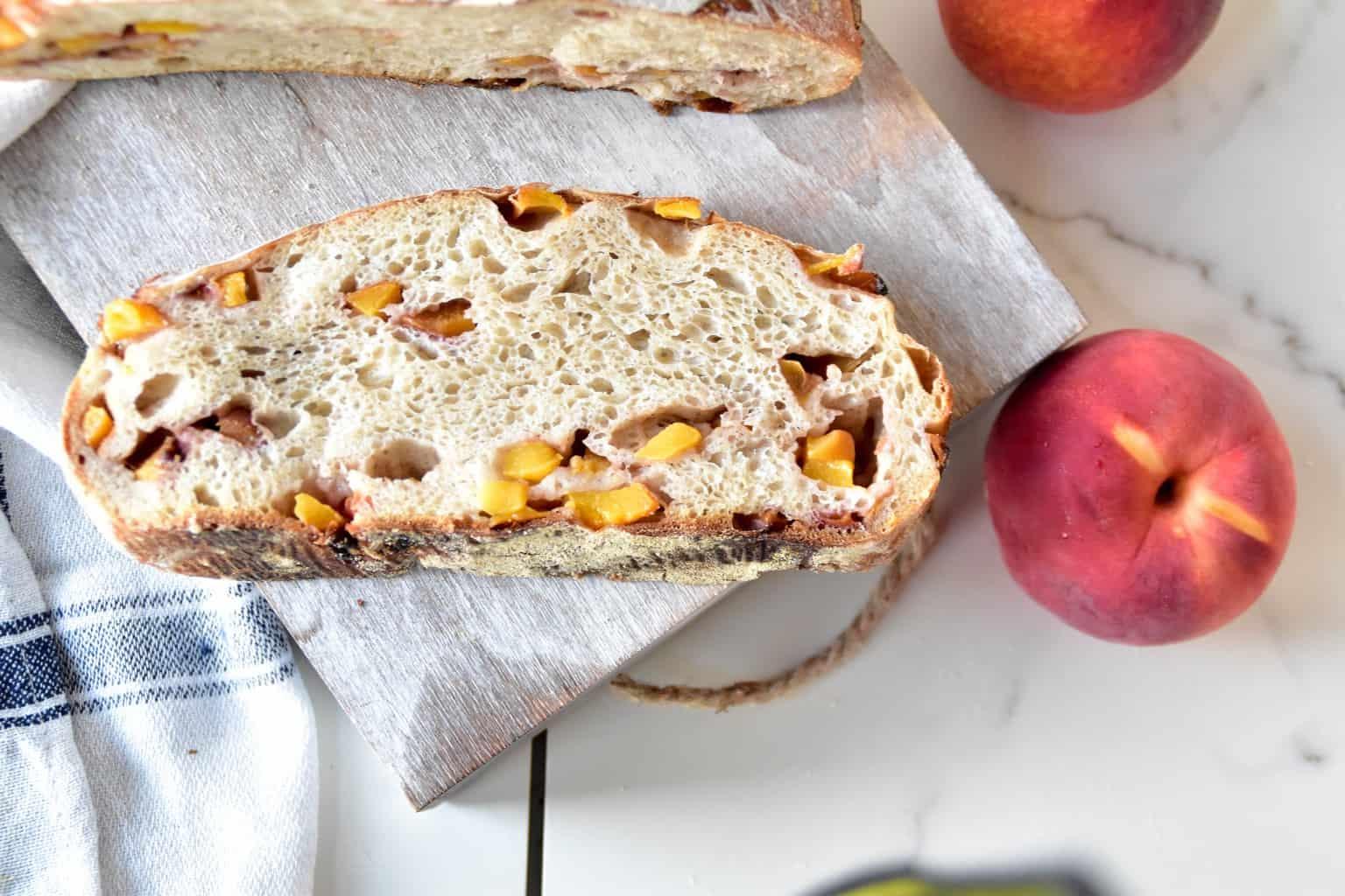 "<img src=""https://cdn.shortpixel.ai/client/q_glossy,ret_img,w_4096,h_2730/peach spelt sourdough bread .jpg"" alt="" slice of peach spelt sourdough bread with peaches"">"