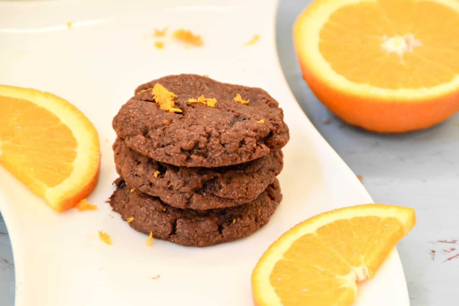 "<img src=""https://cdn.shortpixel.ai/client/q_glossy,ret_img,w_4096,h_2730/Vegan double chocolate orange cookies.jpg"" alt=""Vegan double chocolate orange cookies"">"