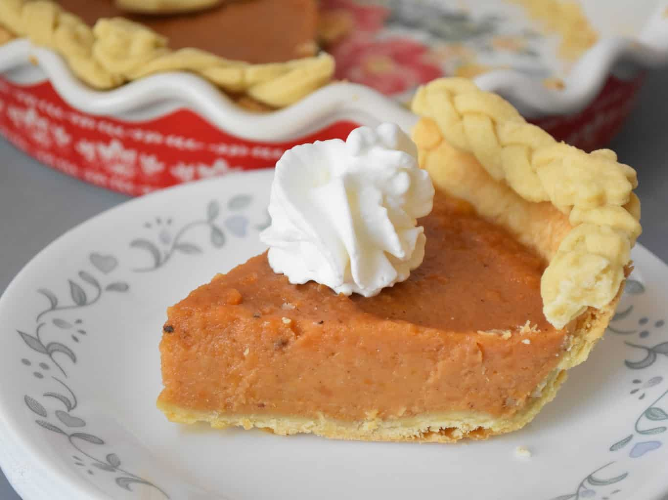 "<img src=""https://cdn.shortpixel.ai/client/q_glossy,ret_img,w_1366,h_1024/Sweet potato pie .jpg"" alt="" slice of Sweet potato pie with whipped cream "">"